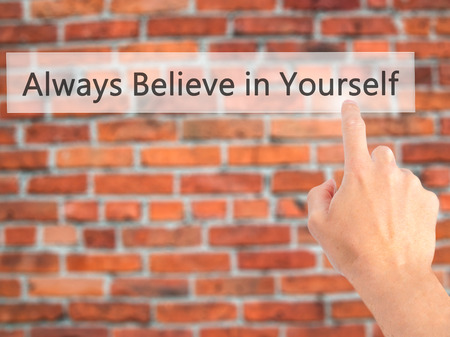 Always Believe in Yourself - Hand pressing a button on blurred background concept . Business, technology, internet concept. Stock Photo