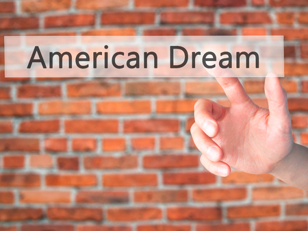 American Dream - Hand pressing a button on blurred background concept . Business, technology, internet concept. Stock Photo Stock Photo