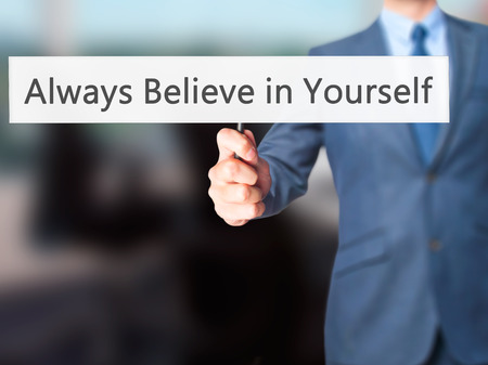 always: Always Believe in Yourself - Businessman hand holding sign. Business, technology, internet concept. Stock Photo Stock Photo