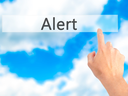 web scam: Alert - Hand pressing a button on blurred background concept . Business, technology, internet concept. Stock Photo Stock Photo