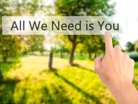 All We Need is You - Hand pressing a button on blurred background concept . Business, technology, internet concept. Stock Photo