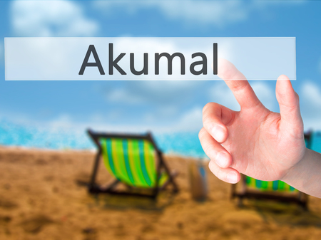 Akumal - Hand pressing a button on blurred background concept . Business, technology, internet concept. Stock Photo Stock Photo