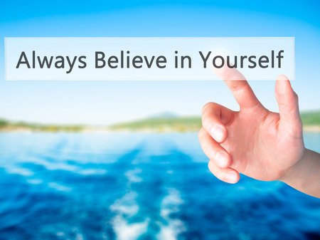 belive: Always Believe in Yourself - Hand pressing a button on blurred background concept . Business, technology, internet concept. Stock Photo