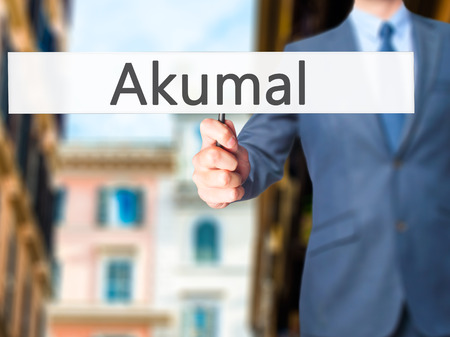 roo: Akumal - Businessman hand holding sign. Business, technology, internet concept. Stock Photo
