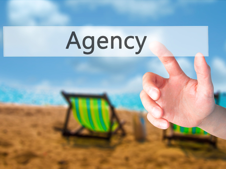 adwords: Agency - Hand pressing a button on blurred background concept . Business, technology, internet concept. Stock Photo Stock Photo
