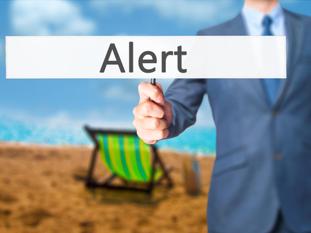 Alert - Businessman hand holding sign. Business, technology, internet concept. Stock Photo
