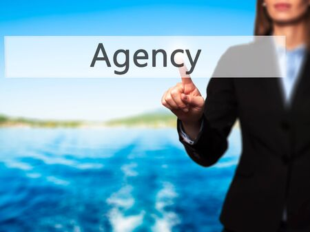 stock agency: Agency - Isolated female hand touching or pointing to button. Business and future technology concept. Stock Photo Stock Photo