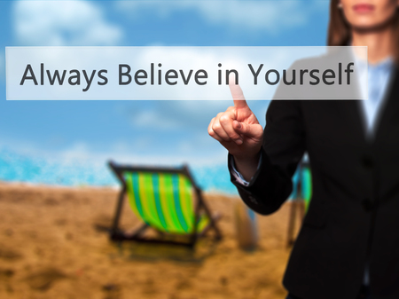 Always Believe in Yourself - Isolated female hand touching or pointing to button. Business and future technology concept. Stock Photo