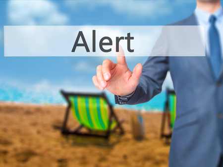Alert  - Businessman press on digital screen. Business,  internet concept. Stock Photo