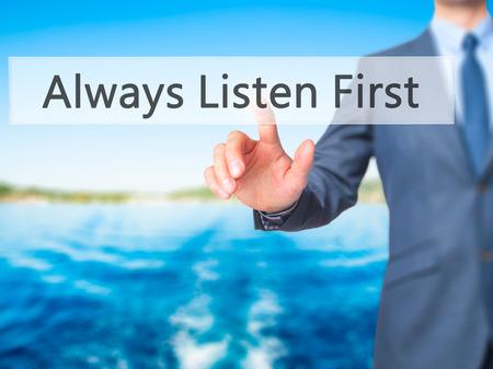 always listen first: Always Listen First - Businessman press on digital screen. Business,  internet concept. Stock Photo