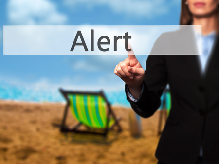 Alert - Isolated female hand touching or pointing to button. Business and future technology concept. Stock Photo Stock Photo