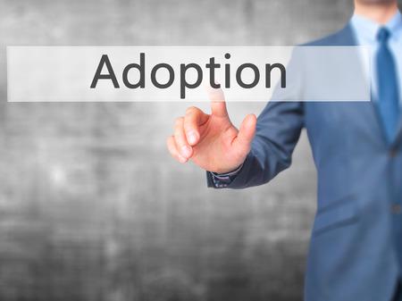 adopting: Adoption - Businessman press on digital screen. Business,  internet concept. Stock Photo