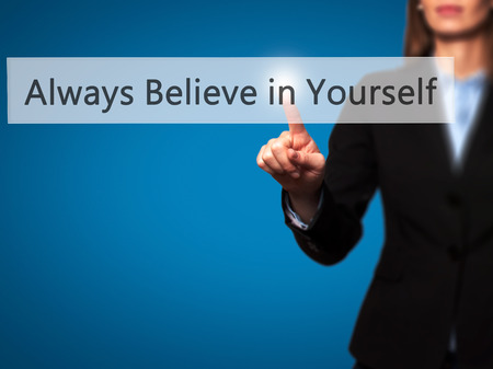 belive: Always Believe in Yourself - Isolated female hand touching or pointing to button. Business and future technology concept. Stock Photo
