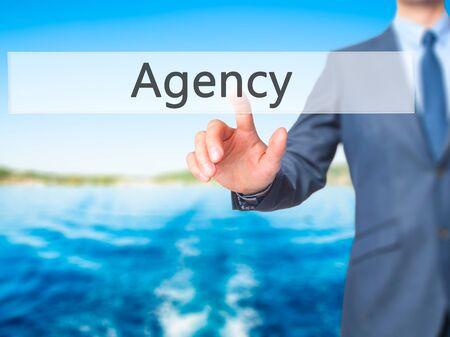 stock agency: Agency - Businessman press on digital screen. Business,  internet concept. Stock Photo Stock Photo