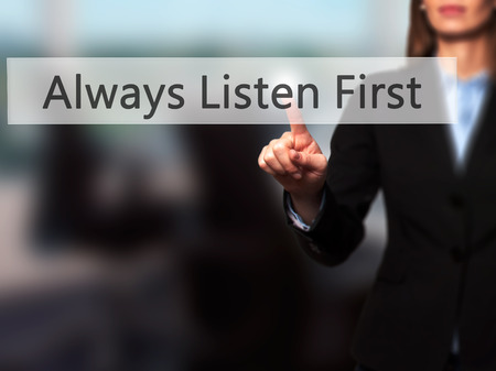 Always Listen First - Isolated female hand touching or pointing to button. Business and future technology concept. Stock Photo Stock Photo