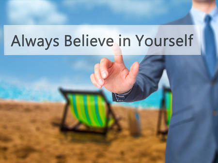 triumphant: Always Believe in Yourself - Businessman press on digital screen. Business,  internet concept. Stock Photo Stock Photo