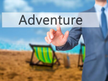 Adventure - Businessman press on digital screen. Business,  internet concept. Stock Photo