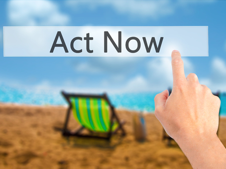 activism: Act Now - Hand pressing a button on blurred background concept . Business, technology, internet concept. Stock Photo