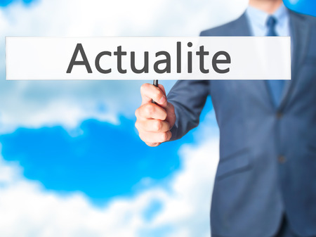 actuality: Actualite (News in French) - Business man showing sign. Business, technology, internet concept. Stock Photo