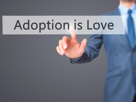 mother in law: Adoption is Love - Businessman press on digital screen. Business,  internet concept. Stock Photo Stock Photo