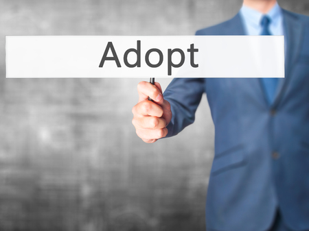 adopting: Adopt - Business man showing sign. Business, technology, internet concept. Stock Photo