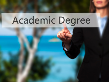 executive courses: Academic Degree - Isolated female hand touching or pointing to button. Business and future technology concept. Stock Photo
