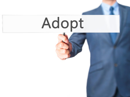 son in law: Adopt - Business man showing sign. Business, technology, internet concept. Stock Photo