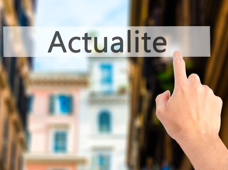 actuality: Actualite (News in French) - Hand pressing a button on blurred background concept . Business, technology, internet concept. Stock Photo Stock Photo