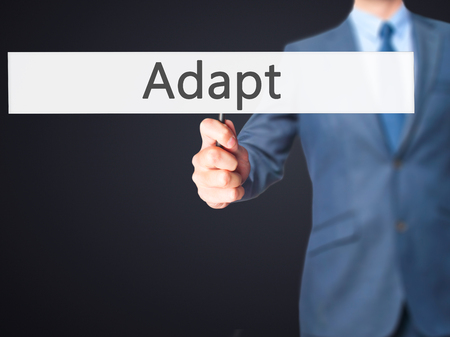 adaptable: Adapt - Business man showing sign. Business, technology, internet concept. Stock Photo