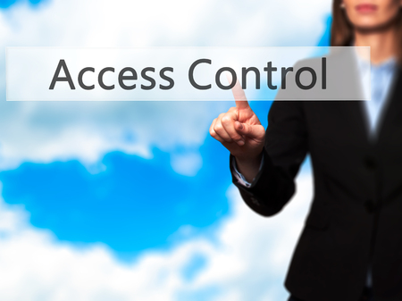 Access Control - Isolated female hand touching or pointing to button. Business and future technology concept. Stock Photo