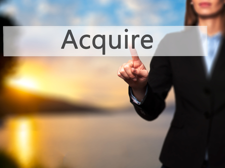 acquiring: Acquire - Isolated female hand touching or pointing to button. Business and future technology concept. Stock Photo Stock Photo