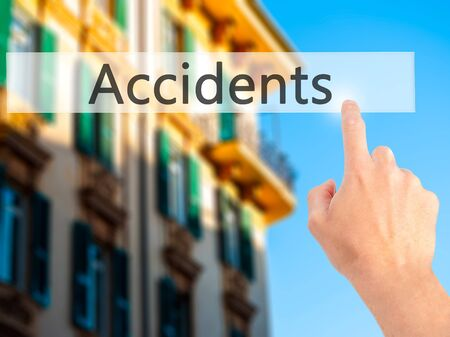 Accidents - Hand pressing a button on blurred background concept . Business, technology, internet concept. Stock Photo