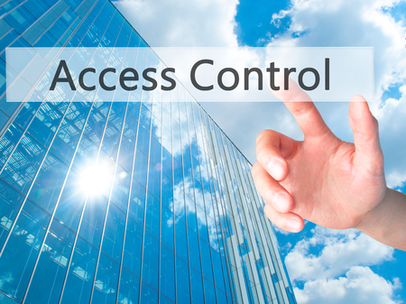 Access Control - Hand pressing a button on blurred background concept . Business, technology, internet concept. Stock Photo Stock Photo