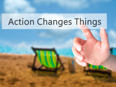 activism: Action Changes Things - Hand pressing a button on blurred background concept . Business, technology, internet concept. Stock Photo Stock Photo