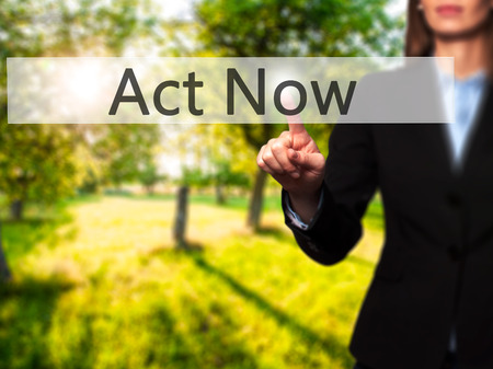 activism: Act Now - Isolated female hand touching or pointing to button. Business and future technology concept. Stock Photo