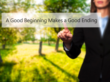 ending: A Good Beginning Makes a Good Ending - Isolated female hand touching or pointing to button. Business and future technology concept. Stock Photo