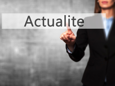 actuality: Actualite (News in French) - Isolated female hand touching or pointing to button. Business and future technology concept. Stock Photo