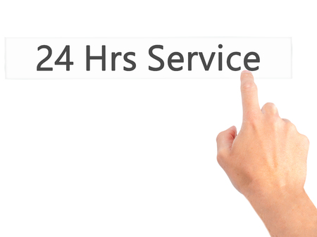 hrs: 24 Hrs Service - Hand pressing a button on blurred background concept . Business, technology, internet concept. Stock Photo Stock Photo