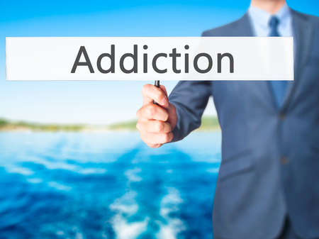 reclamation: Addiction - Business man showing sign. Business, technology, internet concept. Stock Photo