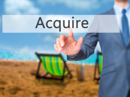 Acquire - Businessman press on digital screen. Business,  internet concept. Stock Photo Stock Photo