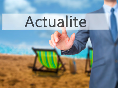 Actualite (News in French) - Businessman press on digital screen. Business,  internet concept. Stock Photo