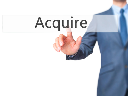 company merger: Acquire - Businessman press on digital screen. Business,  internet concept. Stock Photo Stock Photo