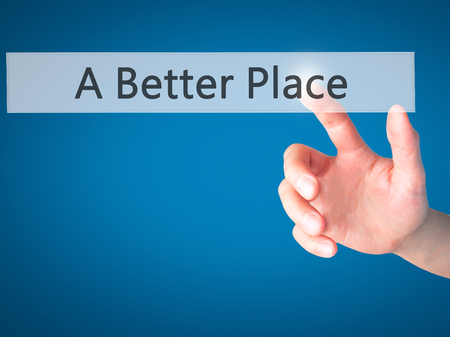 better button: A Better Place - Hand pressing a button on blurred background concept . Business, technology, internet concept. Stock Photo Stock Photo