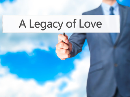 legacy: A Legacy of Love - Business man showing sign. Business, technology, internet concept. Stock Photo Stock Photo
