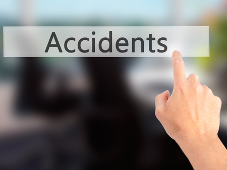 t bar: Accidents - Hand pressing a button on blurred background concept . Business, technology, internet concept. Stock Photo