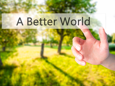 A Better World - Hand pressing a button on blurred background concept . Business, technology, internet concept. Stock Photo Stock Photo