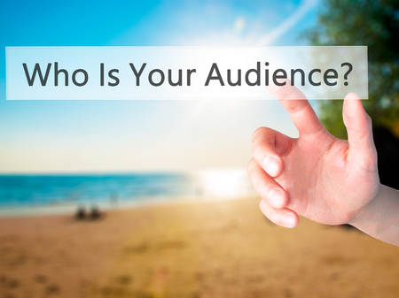 Who Is Your Audience? - Hand pressing a button on blurred background concept . Business, technology, internet concept. Stock Photo Stok Fotoğraf