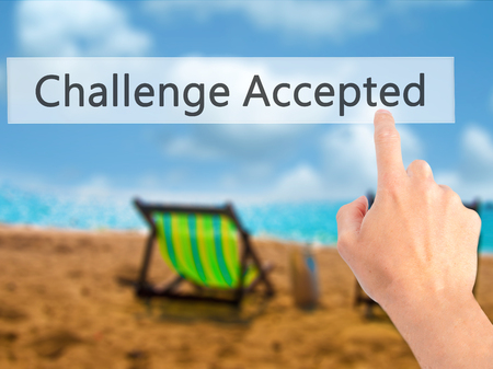 difficult task: Challenge Accepted - Hand pressing a button on blurred background concept . Business, technology, internet concept. Stock Photo