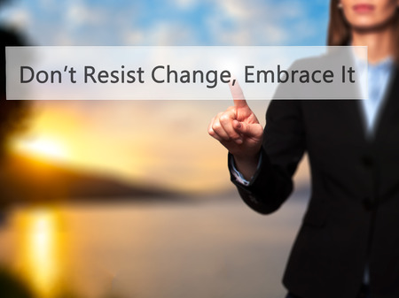 motivator: Dont Resist Change, Embrace It! - Businesswoman hand pressing button on touch screen interface. Business, technology, internet concept. Stock Photo