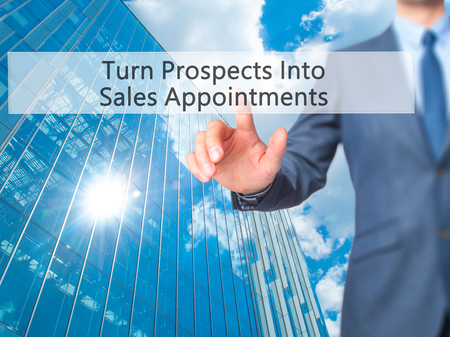 Turn Prospects Into Sales Appointments - Businessman hand pressing button on touch screen interface. Business, technology, internet concept. Stock Photo Stock Photo